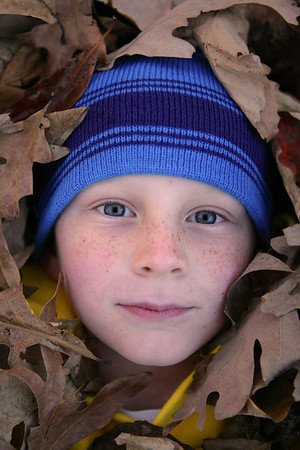 Playing in the leaves at Trout Pond Recreation Area, West Virginia. Nov 2013.